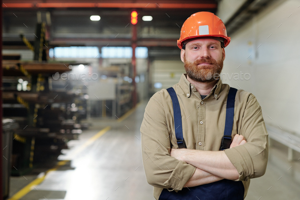 Brutal factory man in hardhat - Stock Photo - Images