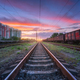 Railway station with freight trains at sunset - PhotoDune Item for Sale