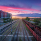 Aerial view of freight trains at sunset. Top view of railroad - PhotoDune Item for Sale