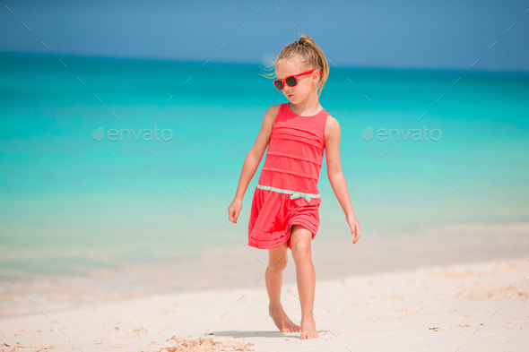Adorable little girl have fun at tropical beach during vacation - Stock Photo - Images