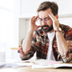 Portrait of young concentrated man thinking while working at home - PhotoDune Item for Sale