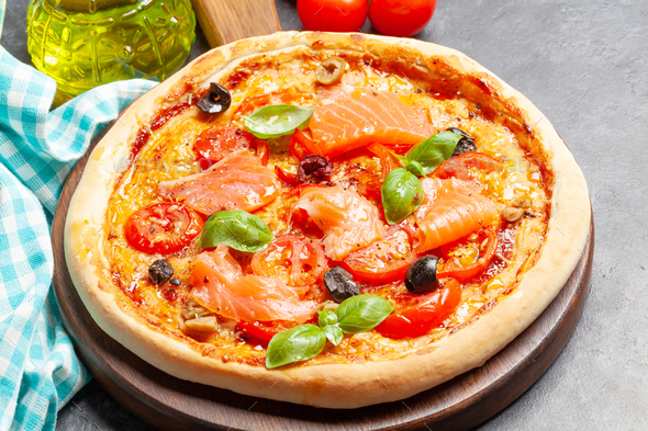 Tasty homemade seafood pizza with salmon - Stock Photo - Images