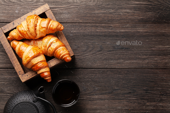 Fresh tasty croissants and tea - Stock Photo - Images