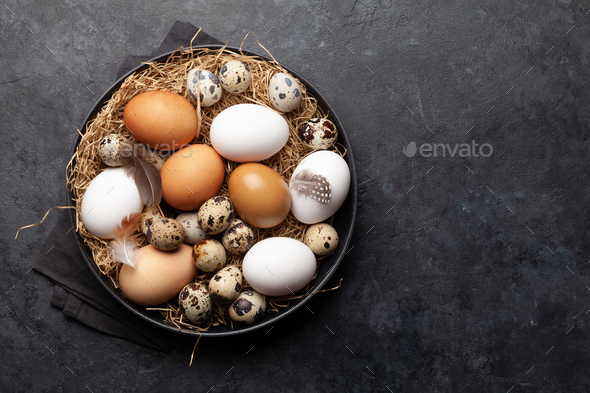 White, brown and quail eggs - Stock Photo - Images