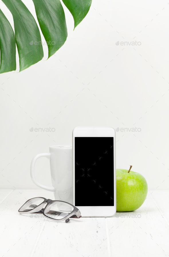 Workplace with smartphone, apple and coffee cup - Stock Photo - Images