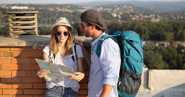 Happy couple on vacation sightseeing city with map - Stock Photo - Images