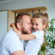 Father and daughter in white spending time at home - PhotoDune Item for Sale