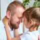 Adorable little girl in white dress hugging loving father - PhotoDune Item for Sale