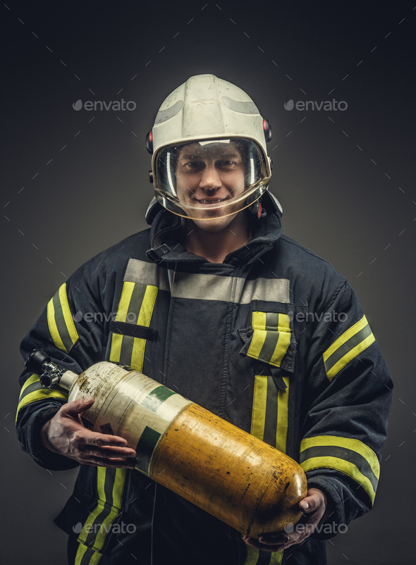 Portrait of firefighter in safety uniform. - Stock Photo - Images
