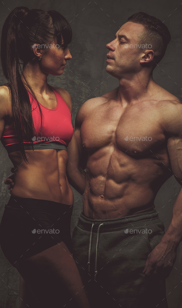 Woman and man bodybuilders posing in studio - Stock Photo - Images