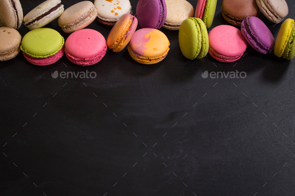 Assorted colorful macaroons on a dark background - Stock Photo - Images