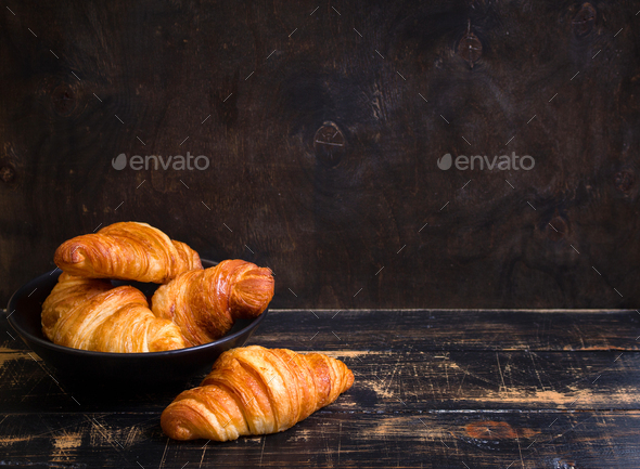 Croissants in a black bowl on the dark background - Stock Photo - Images