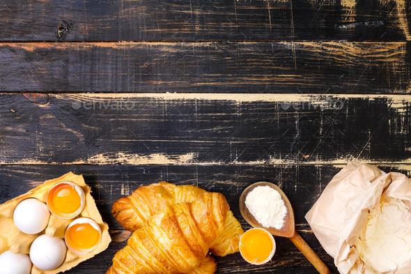 Croissants, flour, eggs, spoon background - Stock Photo - Images