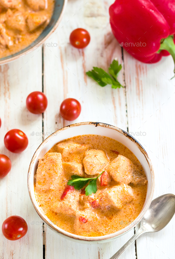 Delicious chicken stew with paprika in a bowl - Stock Photo - Images