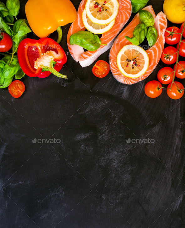 Raw salmon steaks and fresh ingredients for cooking - Stock Photo - Images