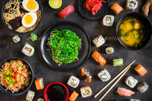 Table served with sushi and traditional japanese food - Stock Photo - Images