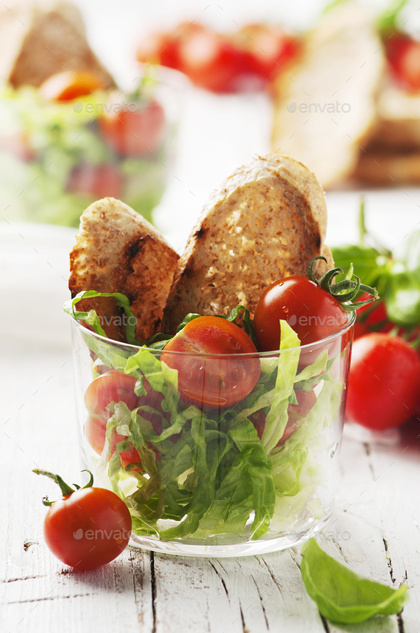 Vegan healthy salad with tomato and bread - Stock Photo - Images