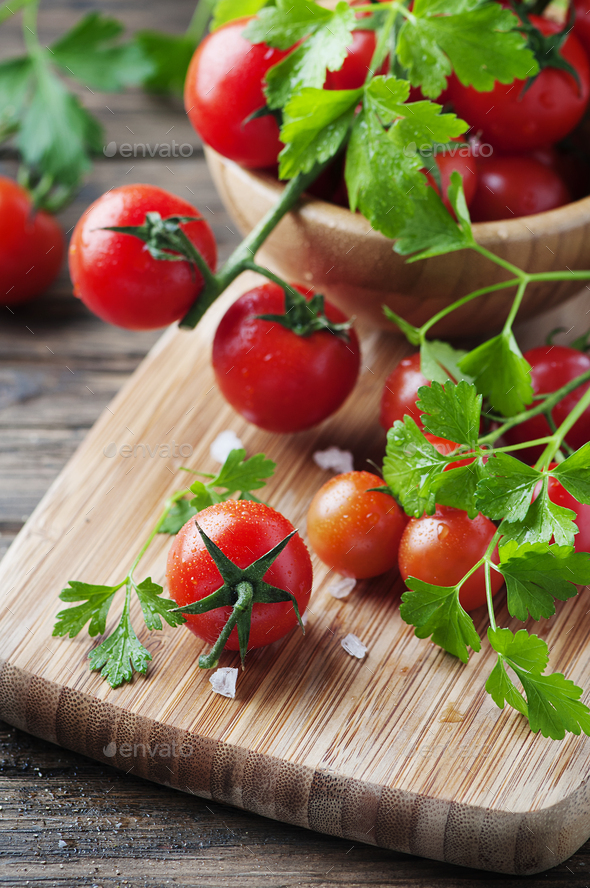 Fresh red tomato with green parsley - Stock Photo - Images