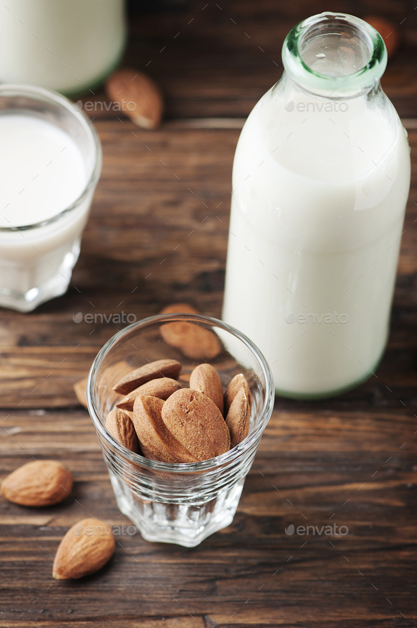 Vegan Almond milk on the vintage table - Stock Photo - Images