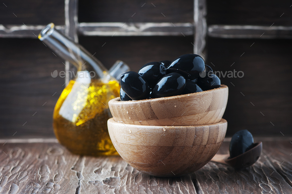 Black olive on the wooden table - Stock Photo - Images