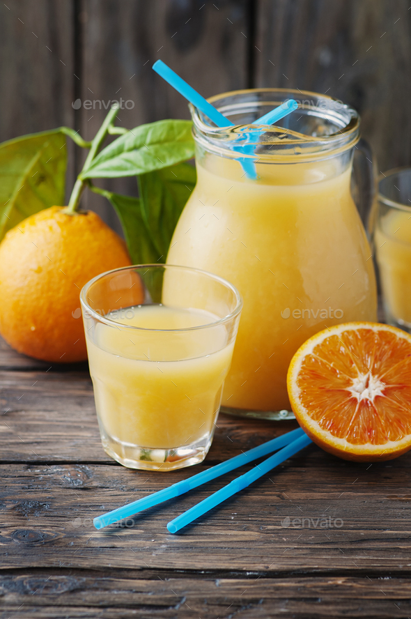 Healthy fresh orange juice on the woodent table - Stock Photo - Images