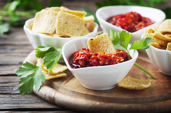 Hot mexican salsa with chili peppers - Stock Photo - Images