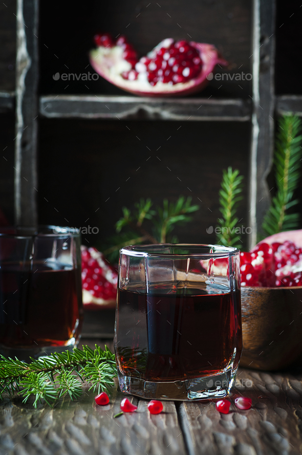 Pomegranate juice on the vintage table - Stock Photo - Images