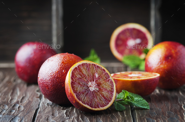 Red sweet oranges on the wooden table - Stock Photo - Images