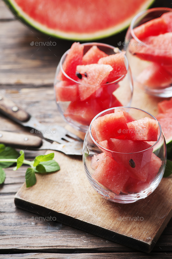 Sweet red watermelon and mint on the wooden table - Stock Photo - Images