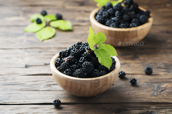 Sweet wild blackberry on the wooden table - Stock Photo - Images