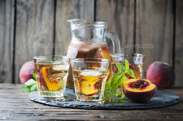 Cold healthy tea with peaches and mint - Stock Photo - Images