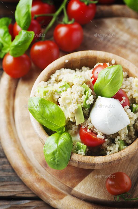 Delicious salad with quinoa, tomato and avocado - Stock Photo - Images