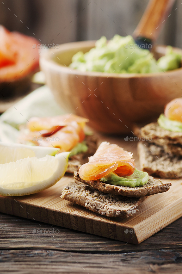 Green mousse with avocado, salmon and bread - Stock Photo - Images