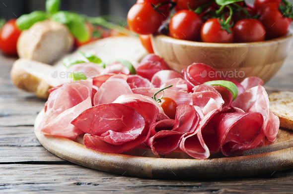 Antipasto with ham and bresaola - Stock Photo - Images