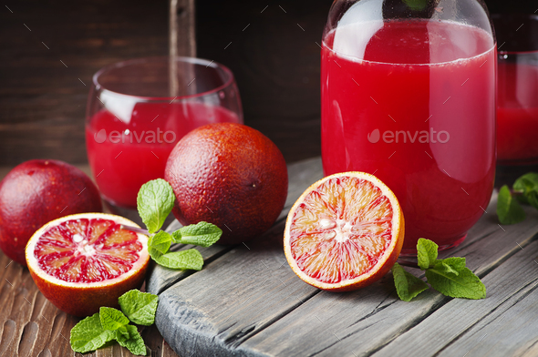 Delicious juice with red oranges and mint - Stock Photo - Images