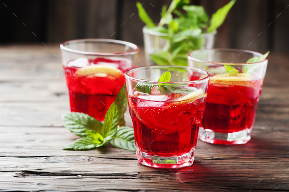 Aperitif with campari, mint and lemon - Stock Photo - Images