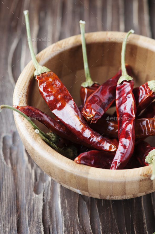 Red hot chili peppers in the wooden bowl - Stock Photo - Images