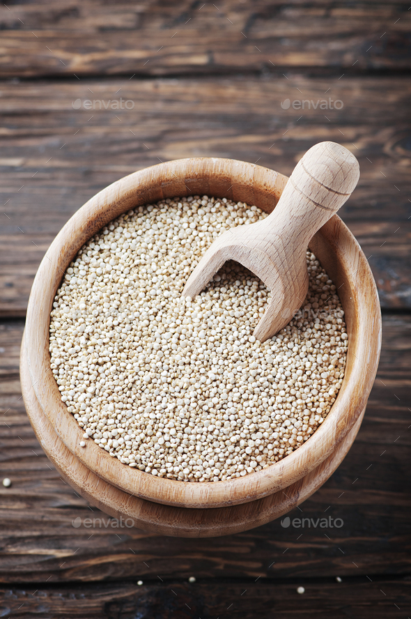 Raw healthy quinoa on the wooden table - Stock Photo - Images
