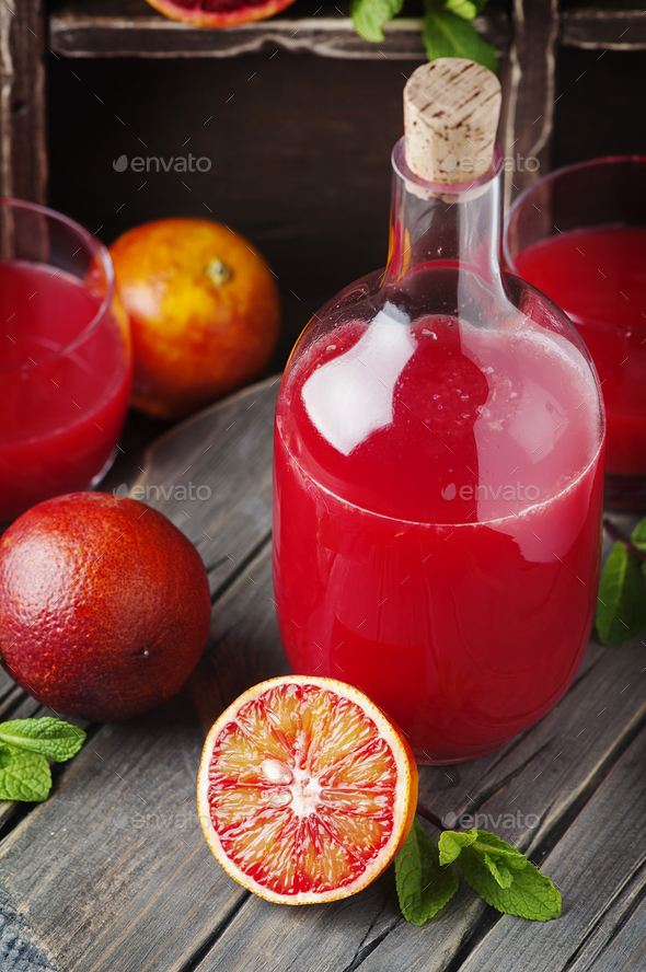 Delicious Sweet juice with red oranges and mint - Stock Photo - Images
