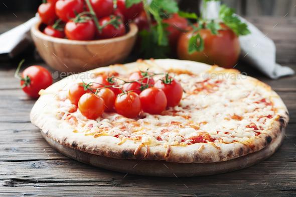 Homemade Italian pizza margherita with tomato - Stock Photo - Images