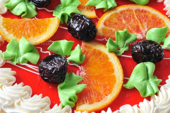 Homemade orange cake with slices oranges and prunes - Stock Photo - Images
