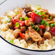 Bulgur and sauteed chicken, mushrooms, eggplants, paprika and tomatoes in a white bowl. - PhotoDune Item for Sale