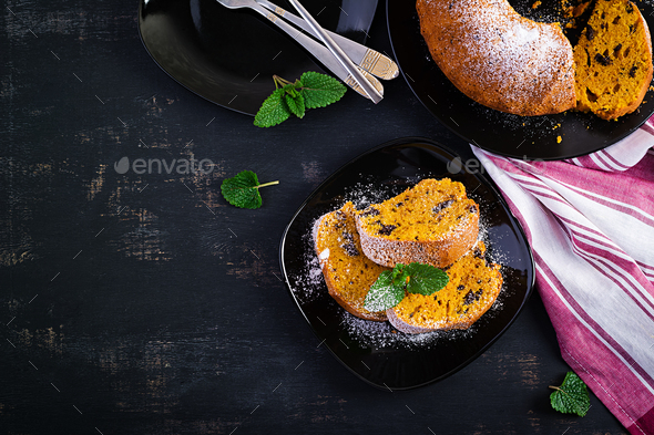 Pumpkin cake with chocolate chips for autumn fall dinner. Vegetarian food. Top view, overhead - Stock Photo - Images