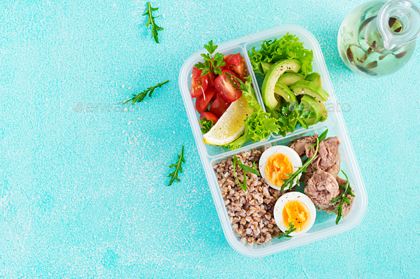 Lunch- Buckwheat porridge, sliced tuna, boiled egg and fresh vegetable salad - Stock Photo - Images