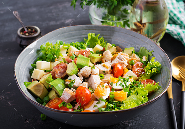 Healthy cobb salad with chicken, avocado, bacon, tomato, cheese and eggs. American food. - Stock Photo - Images