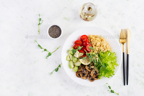 Vegan Buddha bowl with lentil, avocado, mushrooms, lettuce, tomatoes - Stock Photo - Images