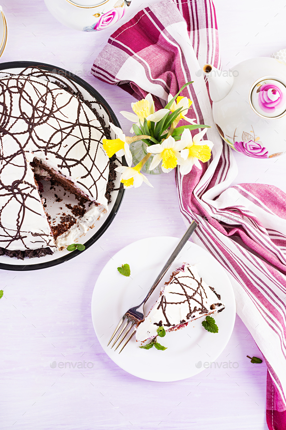 Chocolate cake with cherries and  cream on light background. Top view, overhead - Stock Photo - Images