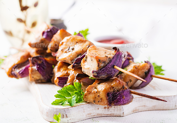 Grilled chicken kebab with red onions on a light table. - Stock Photo - Images
