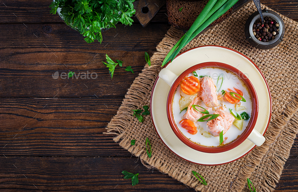 Creamy soup with salmon, potatoes, onions and carrots and  in a bowl. - Stock Photo - Images