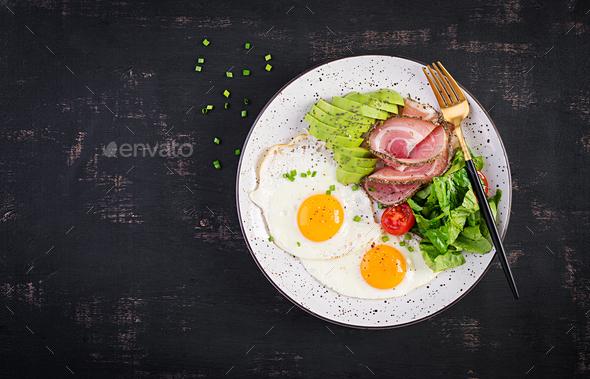 Fried eggs, ham, avocado and fresh salad.  Keto breakfast. Brunch. - Stock Photo - Images
